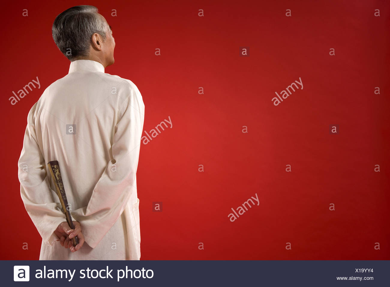 Elderly Man With Fan Staring Into Distance - Stock Image