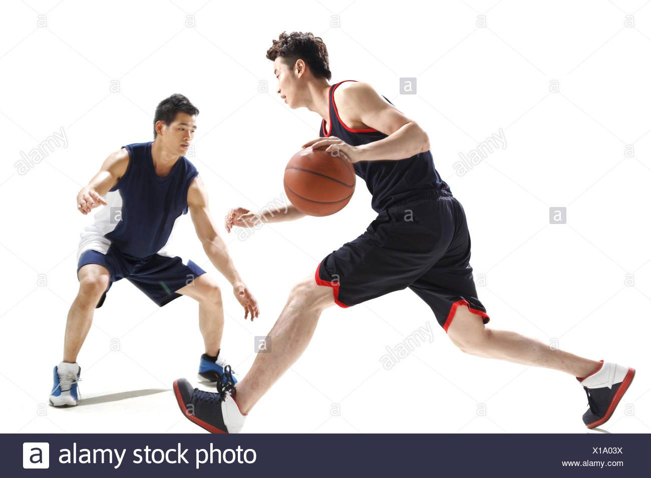 A Woman Playing Basketball Imágenes De Stock A Woman: Passing Basketball Stock Photos & Passing Basketball Stock