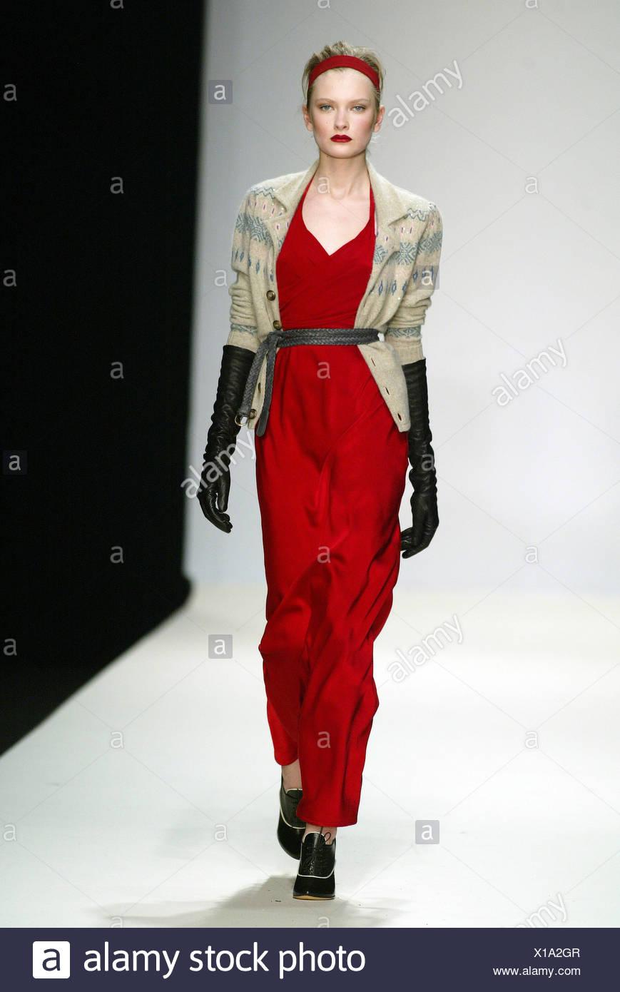 c304ea8165c Ghost London Ready to Wear Autumn Winter Blonde female model wearing full  length red silk halter dress worn under an oatmeal