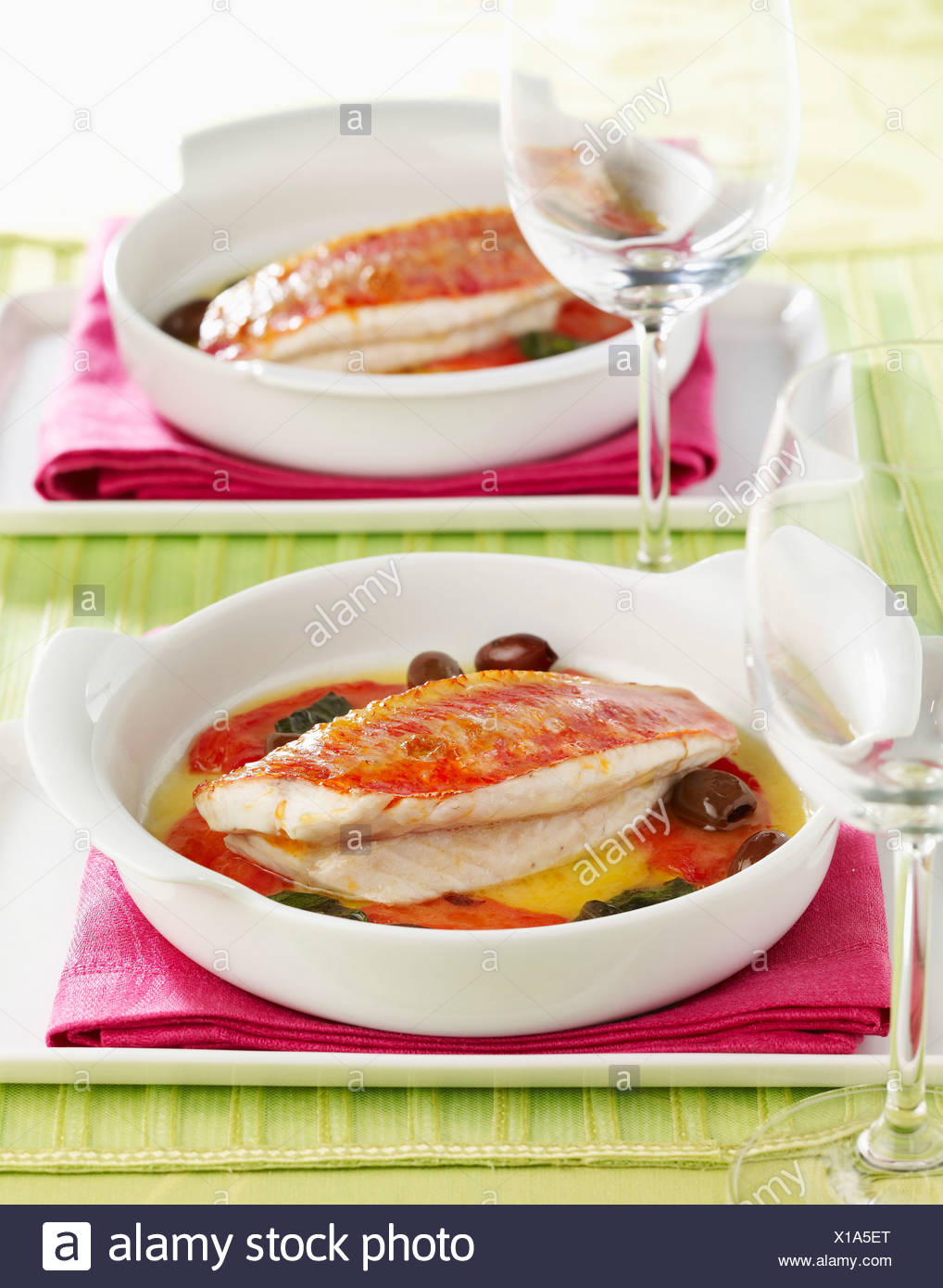 Oven-baked red mullet fillets Stock Photo