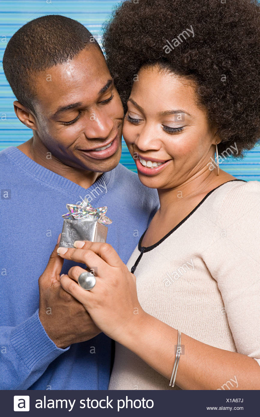 Couple with gift - Stock Image