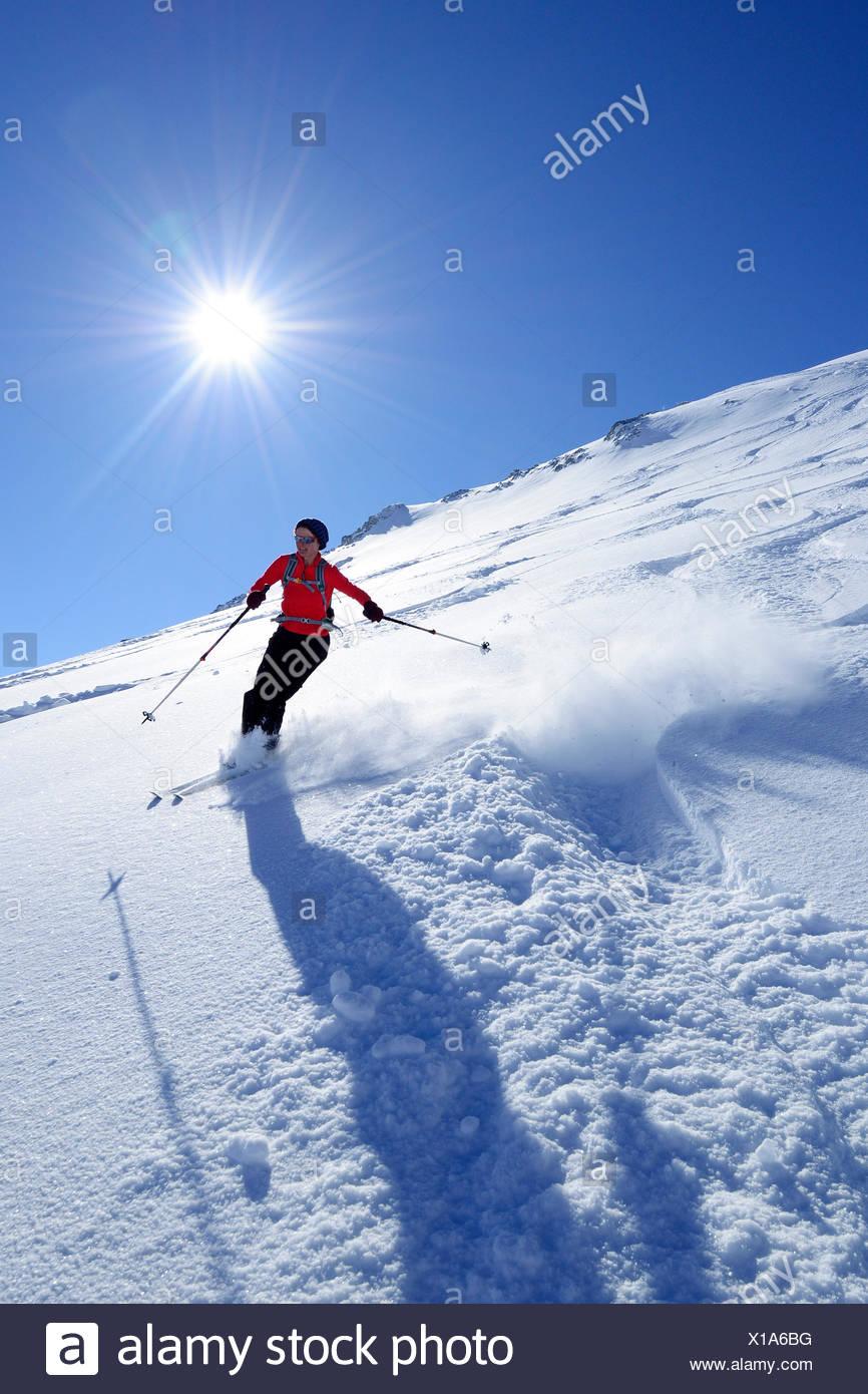 Woman downhill skiing, Birnhorn, Leoganger Steinberge, Salzburg, Austria - Stock Image