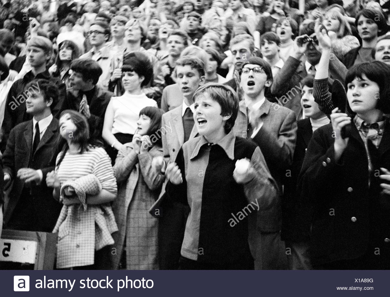 1960th 1966 Sixties follower fans excitement beat concert the Beatles enthusiasm Germany emotions Essen Grugahalle group youth - Stock Image