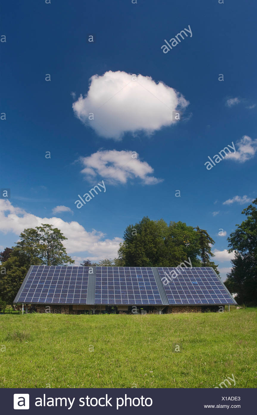Solar panels on the roof of a shed, PublicGround - Stock Image