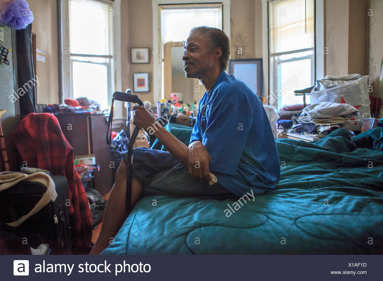 Man with Traumatic Brain Injury in his home - Stock Image