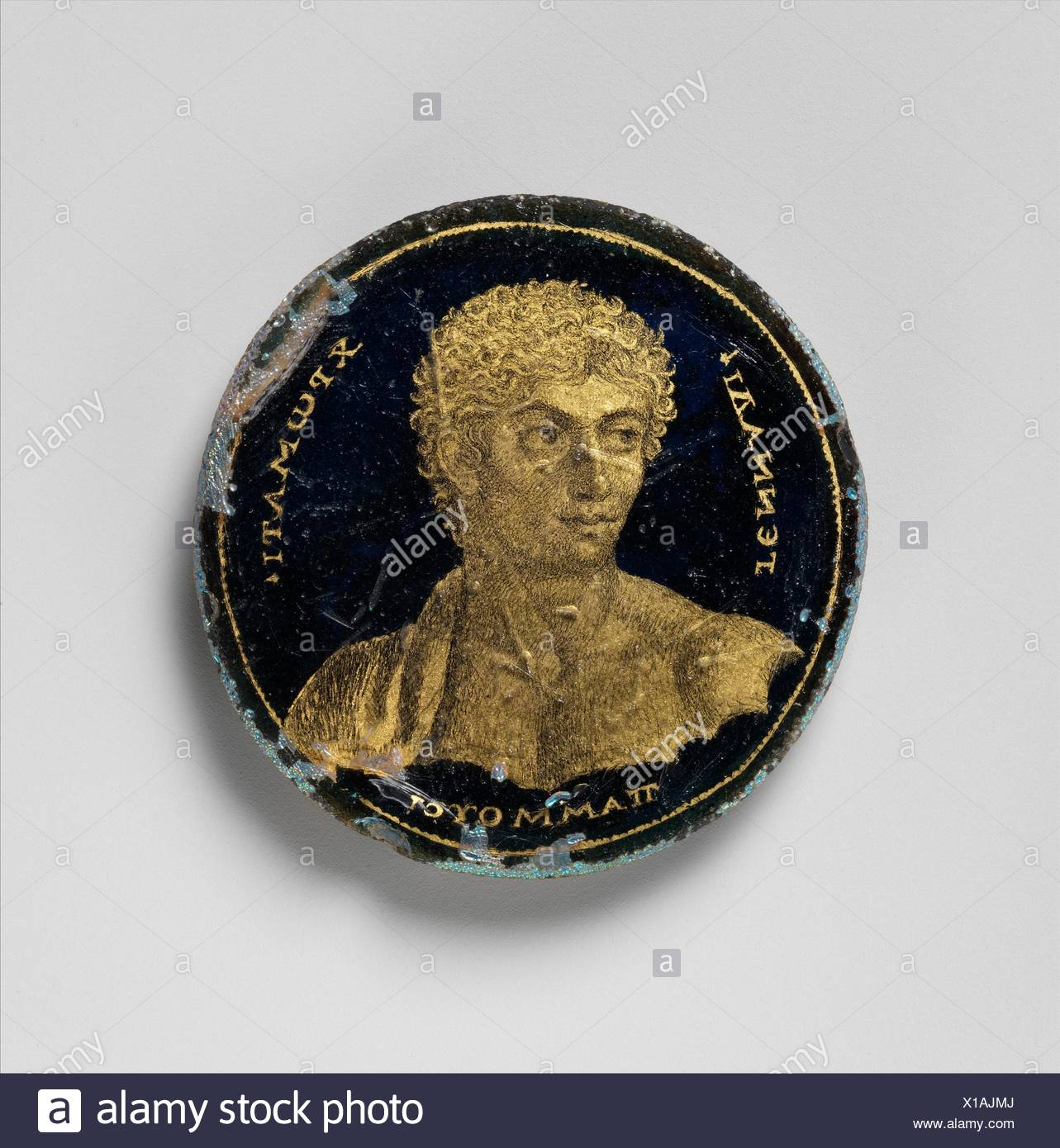 Medallion with a Portrait of Gennadios. Date: 250-300; Geography: Made in Alexandria, Egypt; Culture: Roman; Medium: Glass, gold leaf, polychromy; - Stock Image