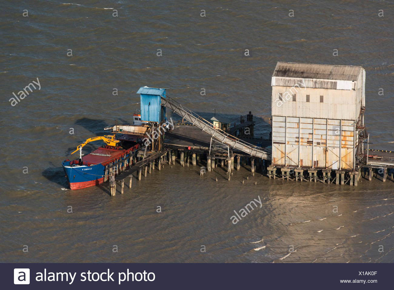 Aerial view of loading sugar on barge to export, coastal Guyana, South America - Stock Image