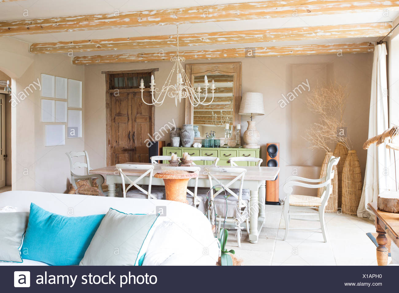 Living and dining area in rustic house - Stock Image