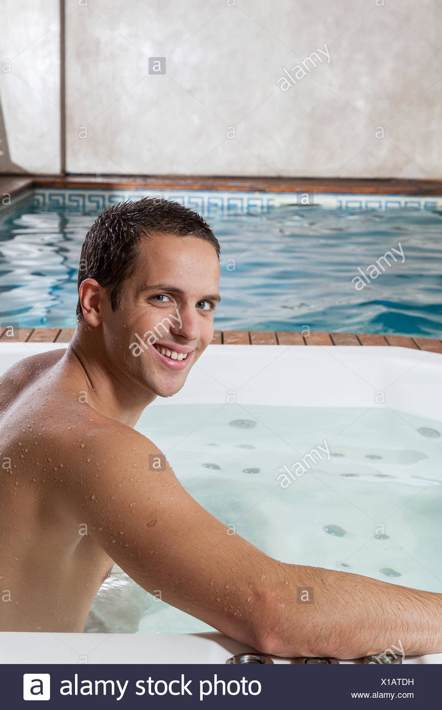 Man inside the jacuzzi - Stock Image