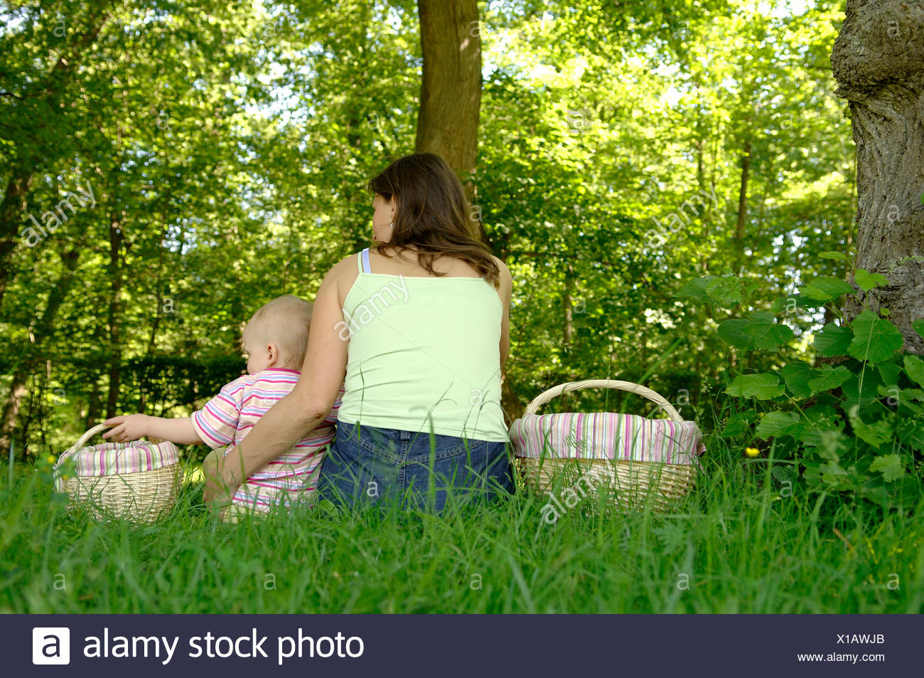 Mother and children in a green countryside Stock Photo