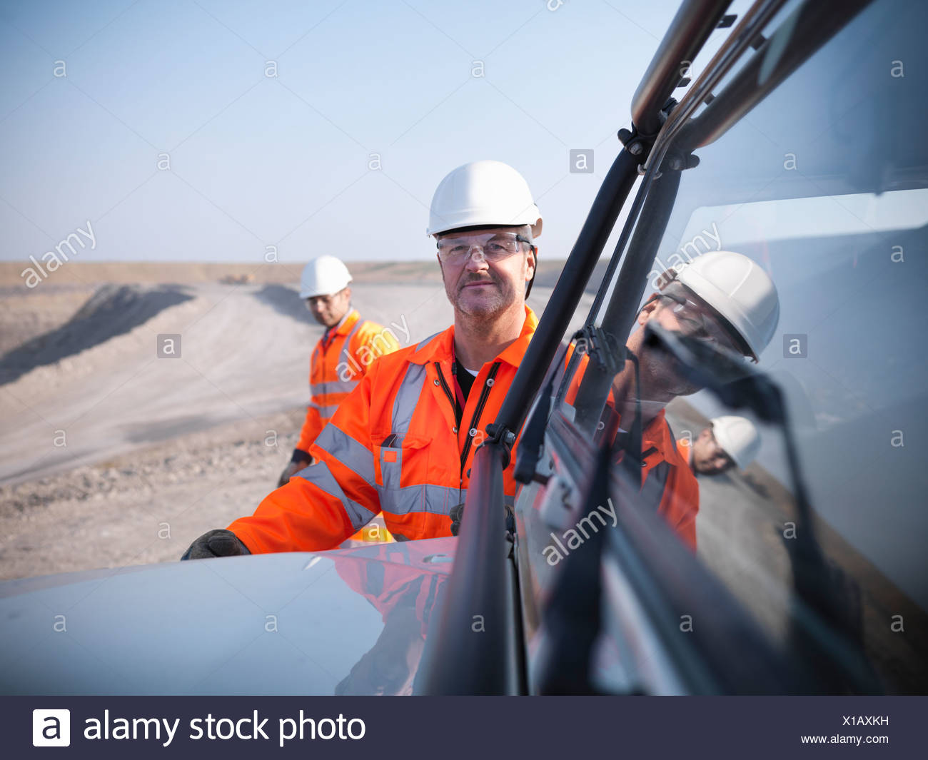 Workers with equipment in coal mine - Stock Image