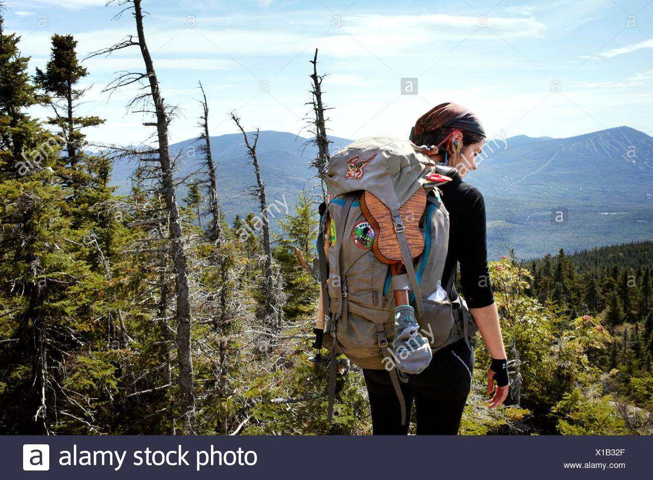 A hiker pauses to reflect. - Stock Image
