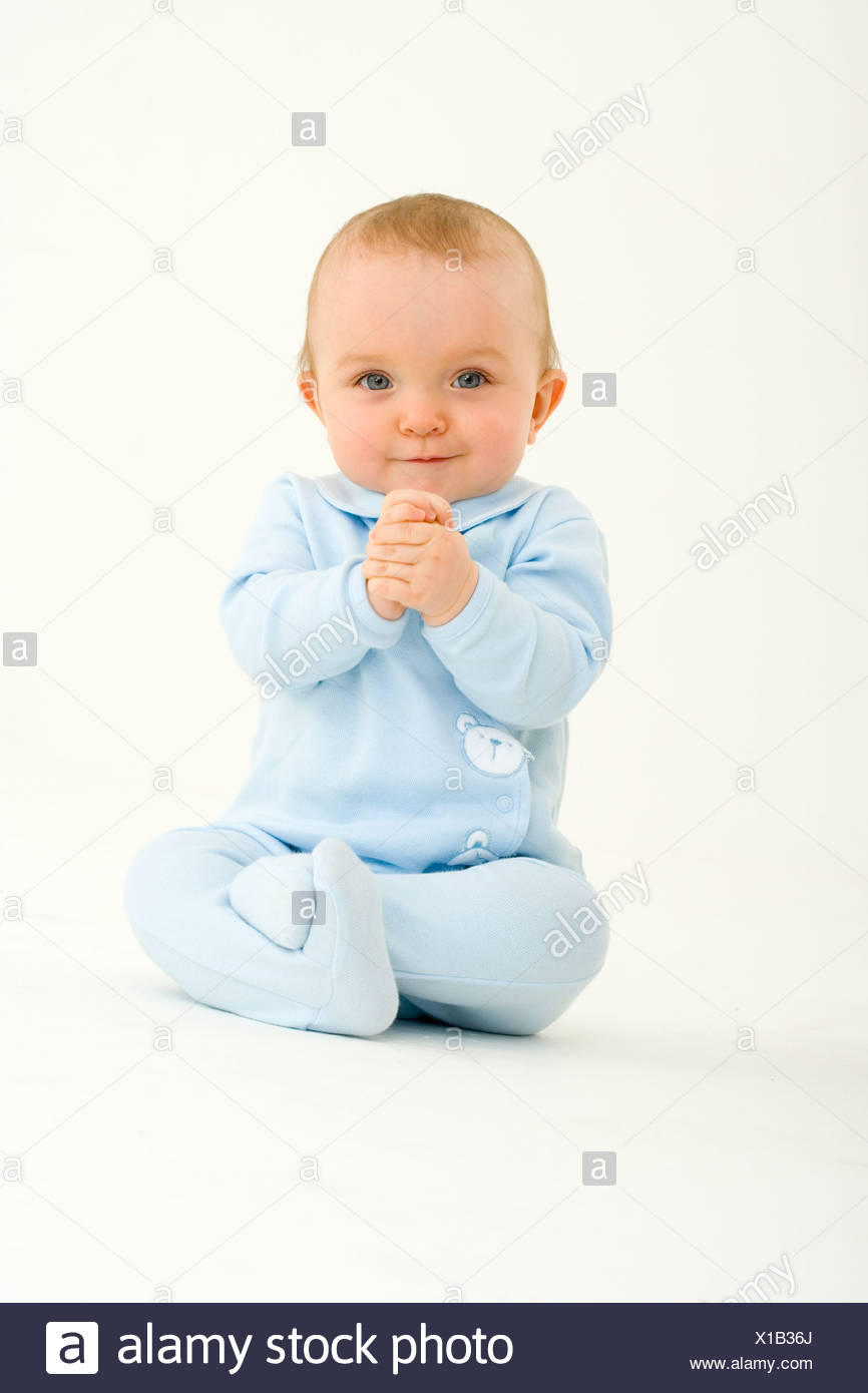 Baby boy 3-6 months, smiling, portrait - Stock Image