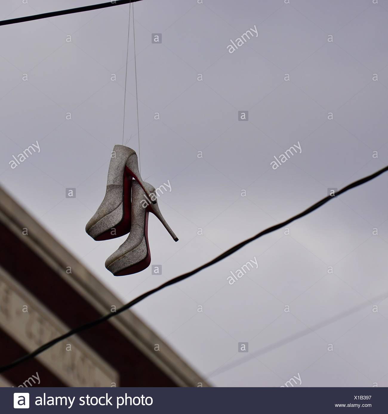Shoes Hanging On Wire Stock Photos & Shoes Hanging On Wire Stock ...