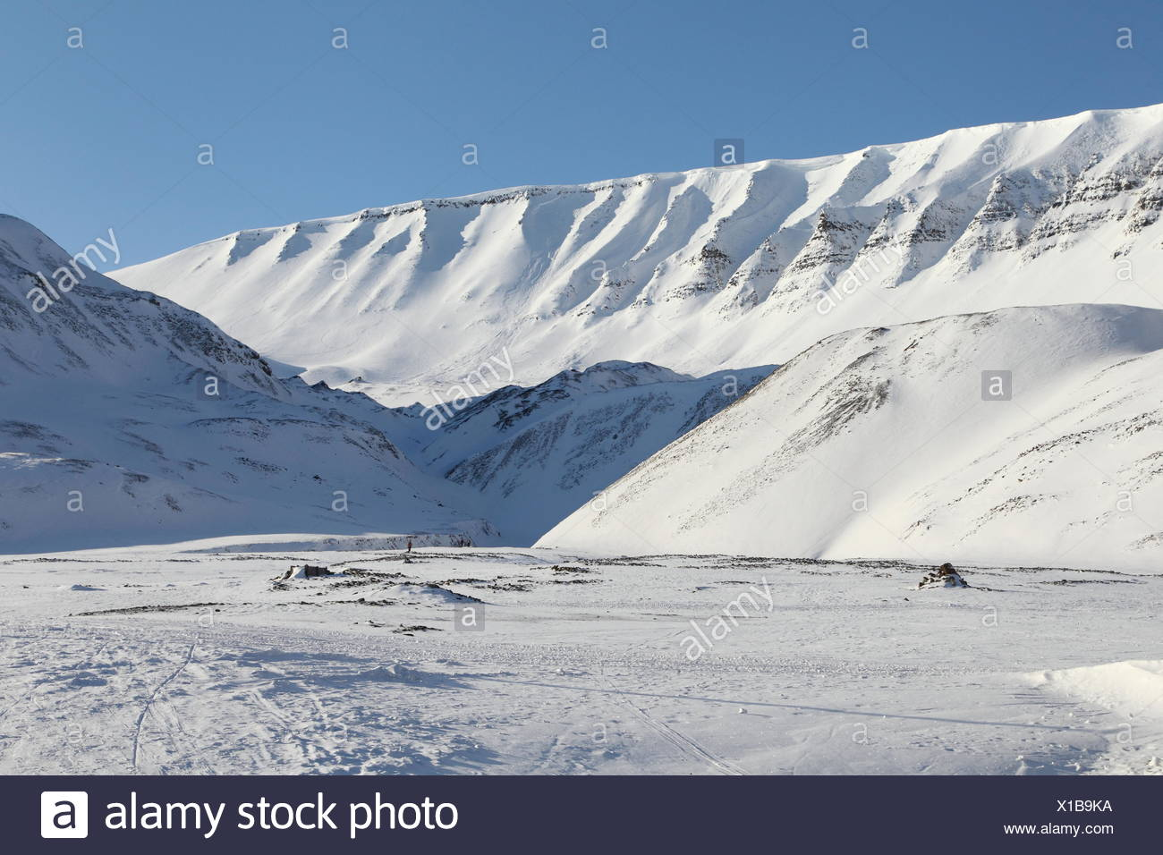 Snow-covered mountains near Longyearbyen - Stock Image