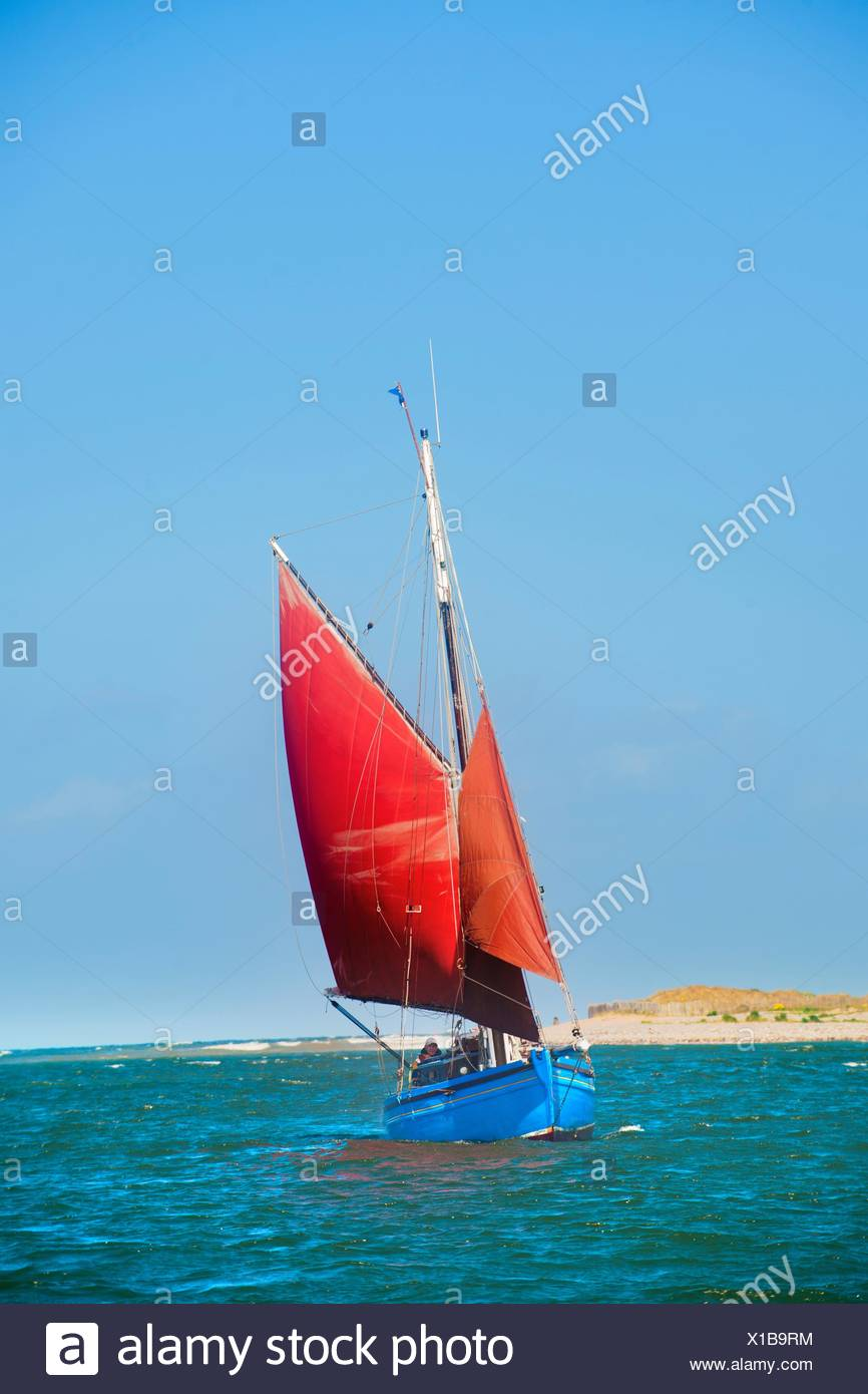 Sailing boat on water Stock Photo