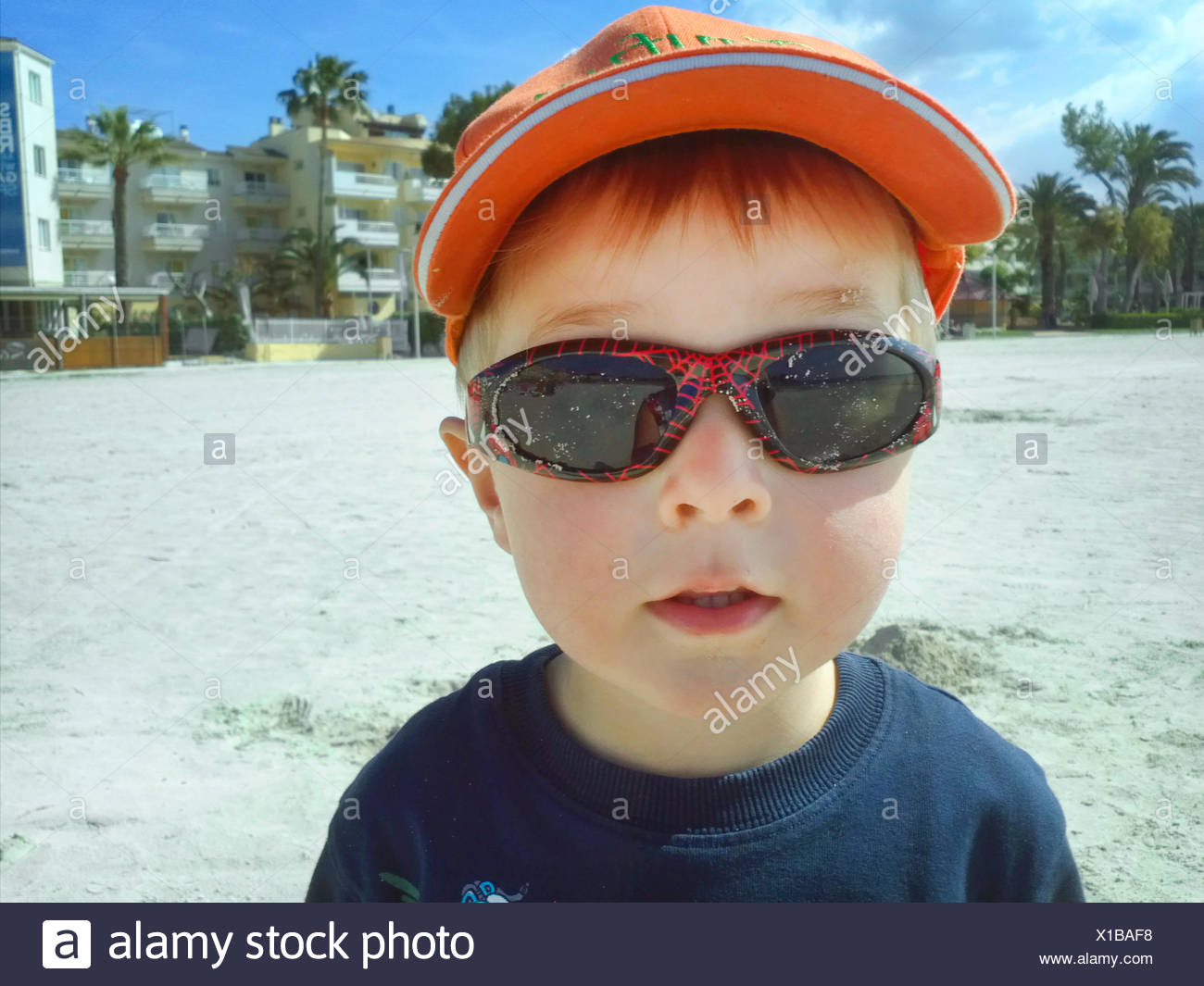1a98011c36e7 cool little boy with sunglasses and baseball cap, Netherlands - Stock Image