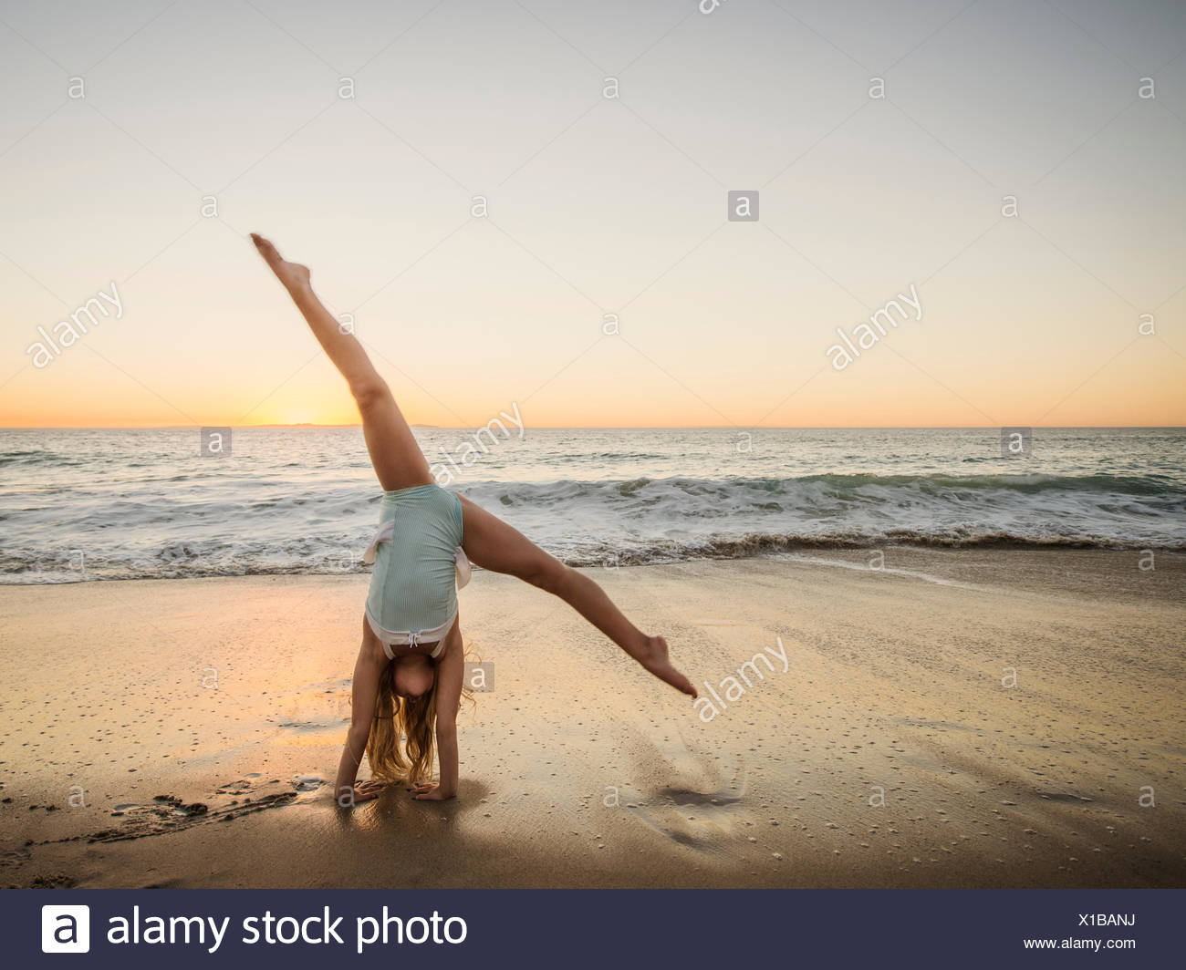 Girl 8 9 Doing Cartwheel On Beach Stock Photo 276230462 Alamy