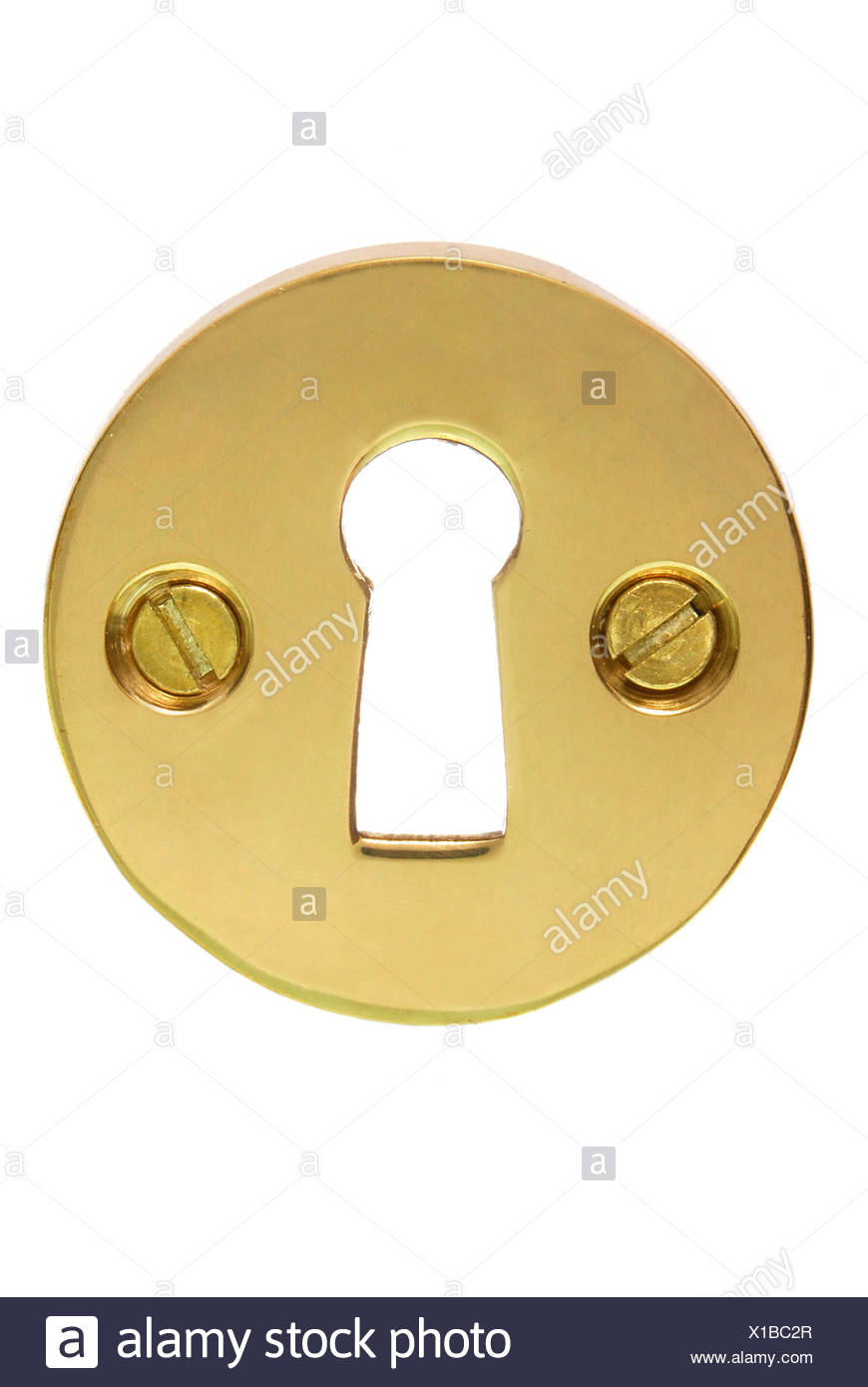 Brass coloured fitting for a keyhole - Stock Image