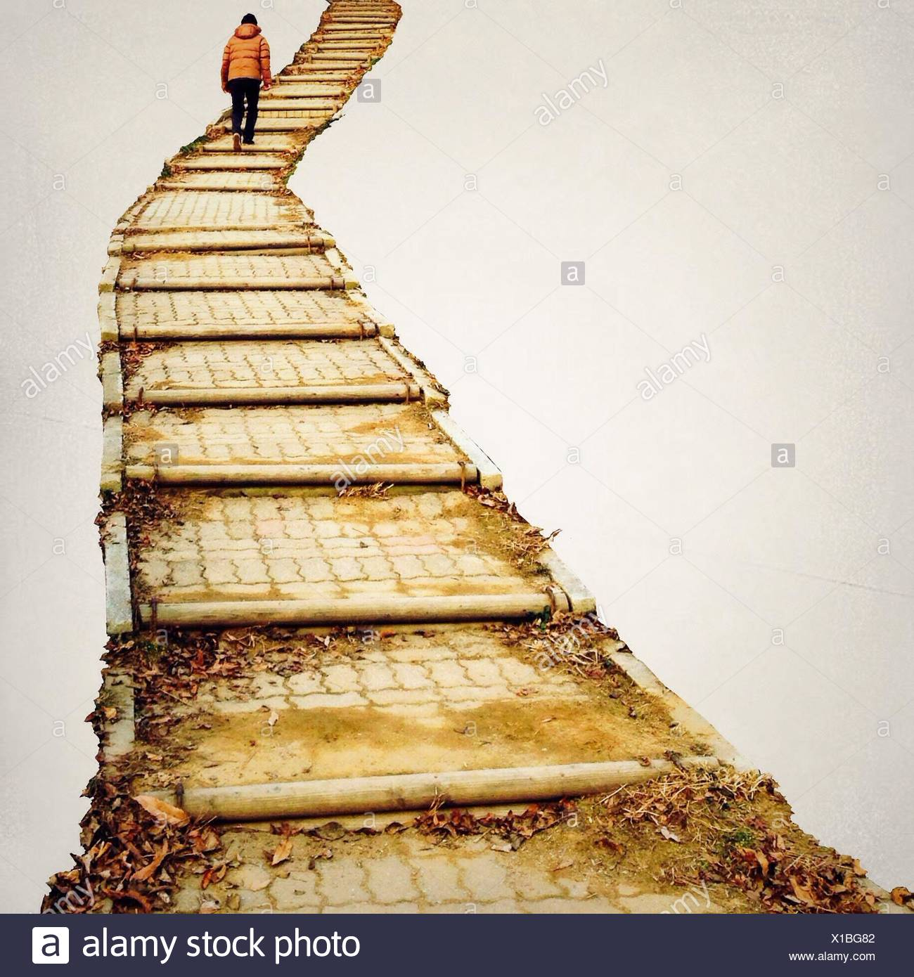 Person going up steps - Stock Image