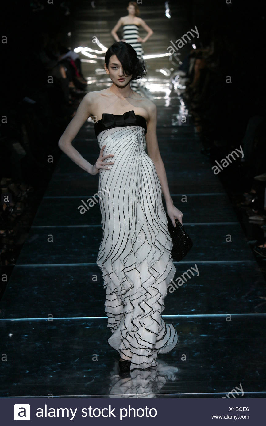 cd0fde7207246 Armani Prive Paris Haute Couture Autumn Winter Model wearing a white  flolength strapless ruffled evening dress a black satin