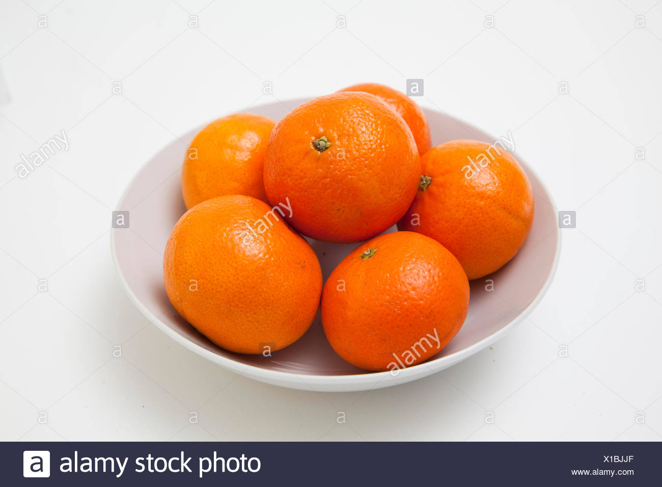 Bowl of oranges - Stock Image
