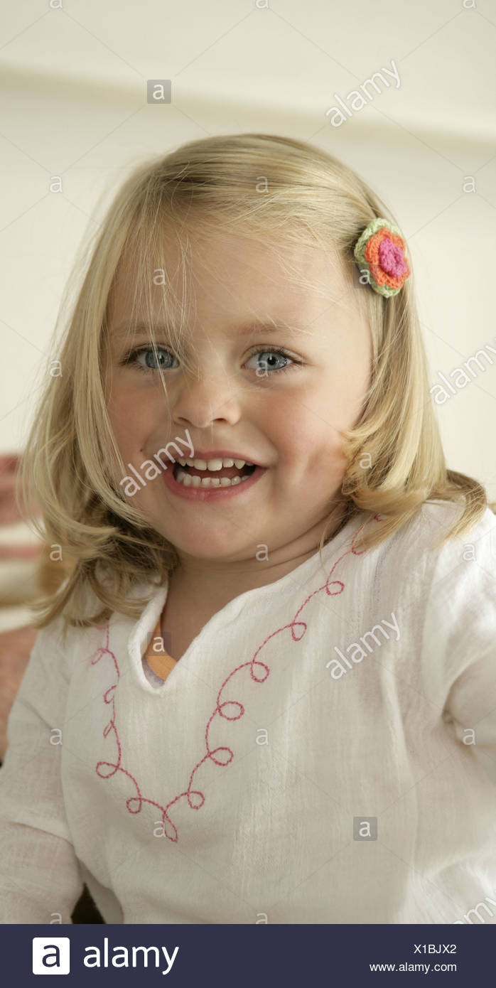 Girl smiling close up portrait - Stock Image