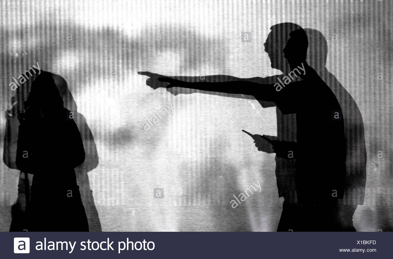 fear silhouette threat subordination authoritarian child man contrast Stock Photo