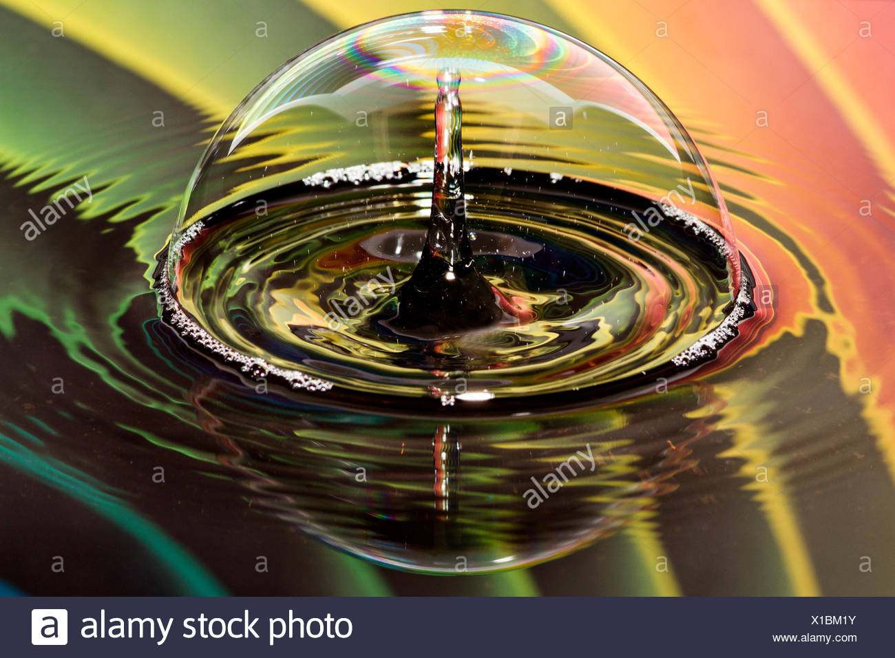 Water drops on bubble with rainbow background Stock Photo
