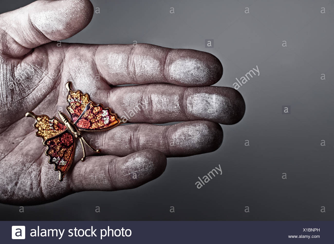 USA, Idaho, Ada County, Boise, Man holding hand made butterfly gift in hand - Stock Image
