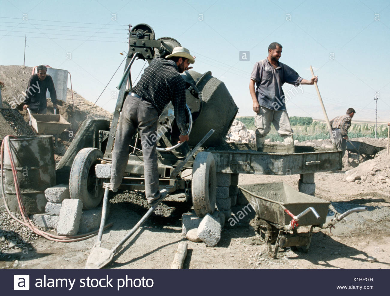 Kurdish workers with cement mixer Kurdistan Iraq 2004 Stock