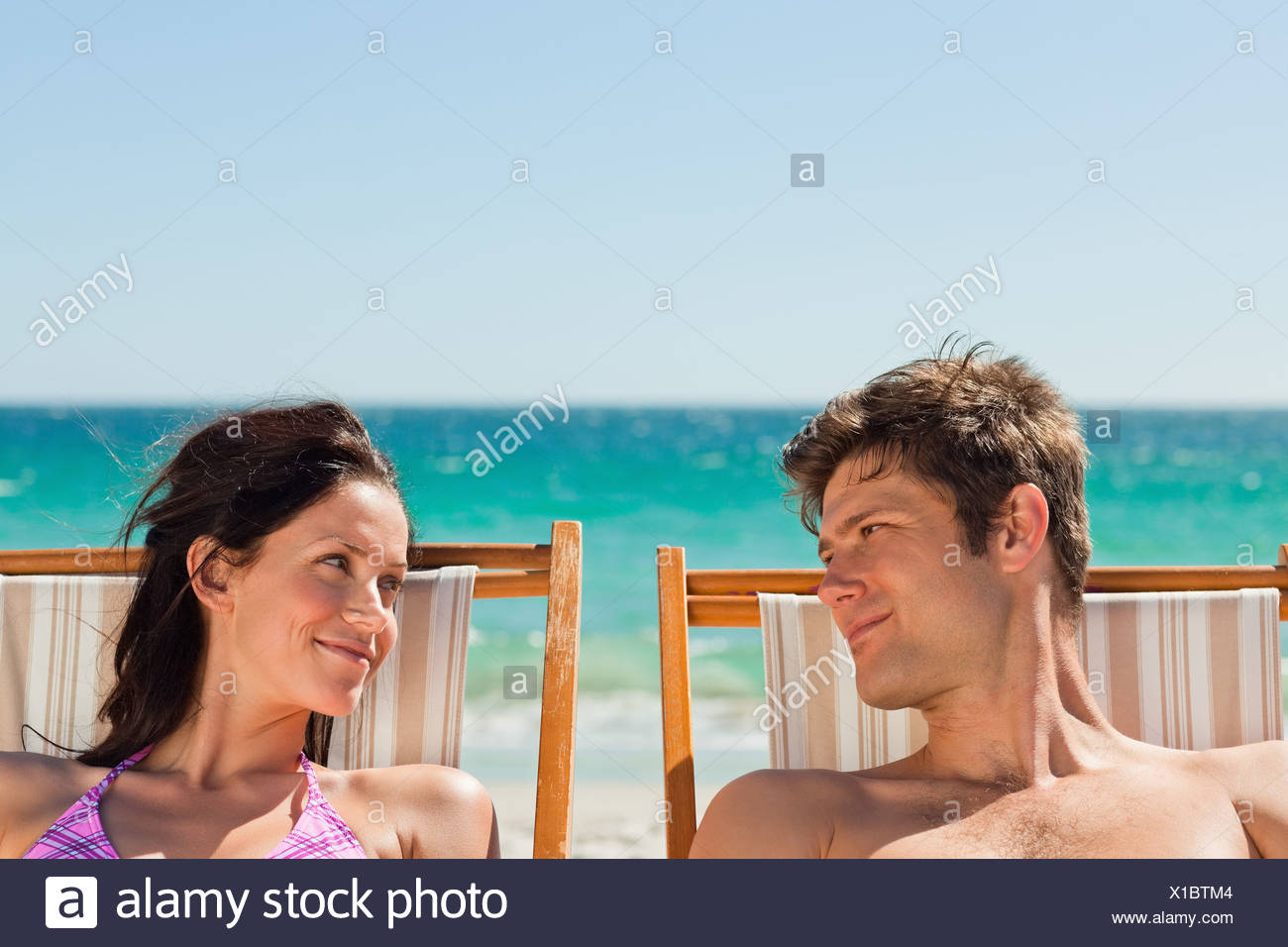 Close-up of lovers taking a sunbath - Stock Image