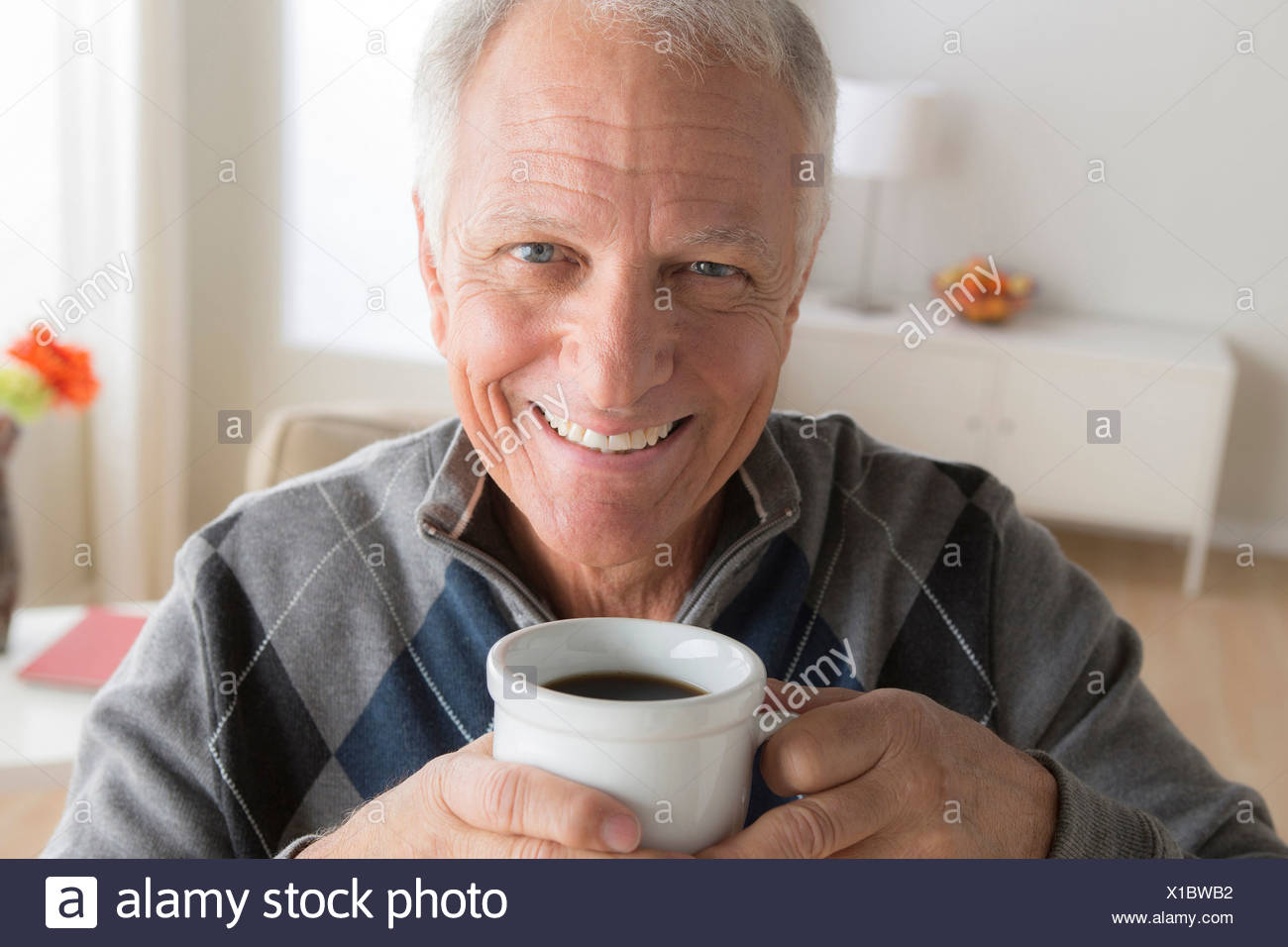 Senior man with cup of coffee - Stock Image