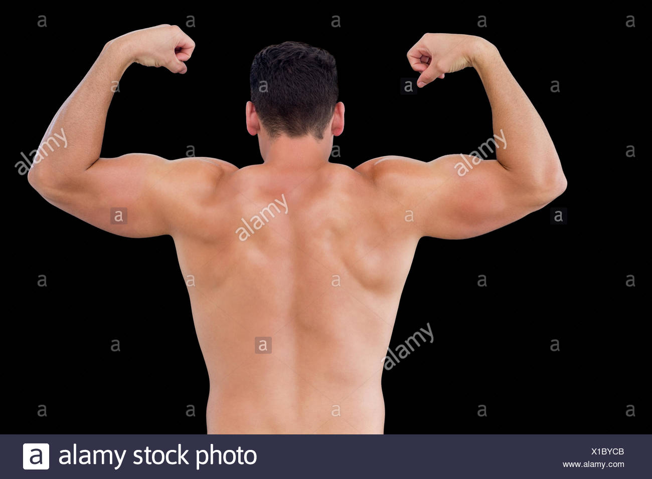 Rear view of shirtless muscular man flexing muscles Stock Photo