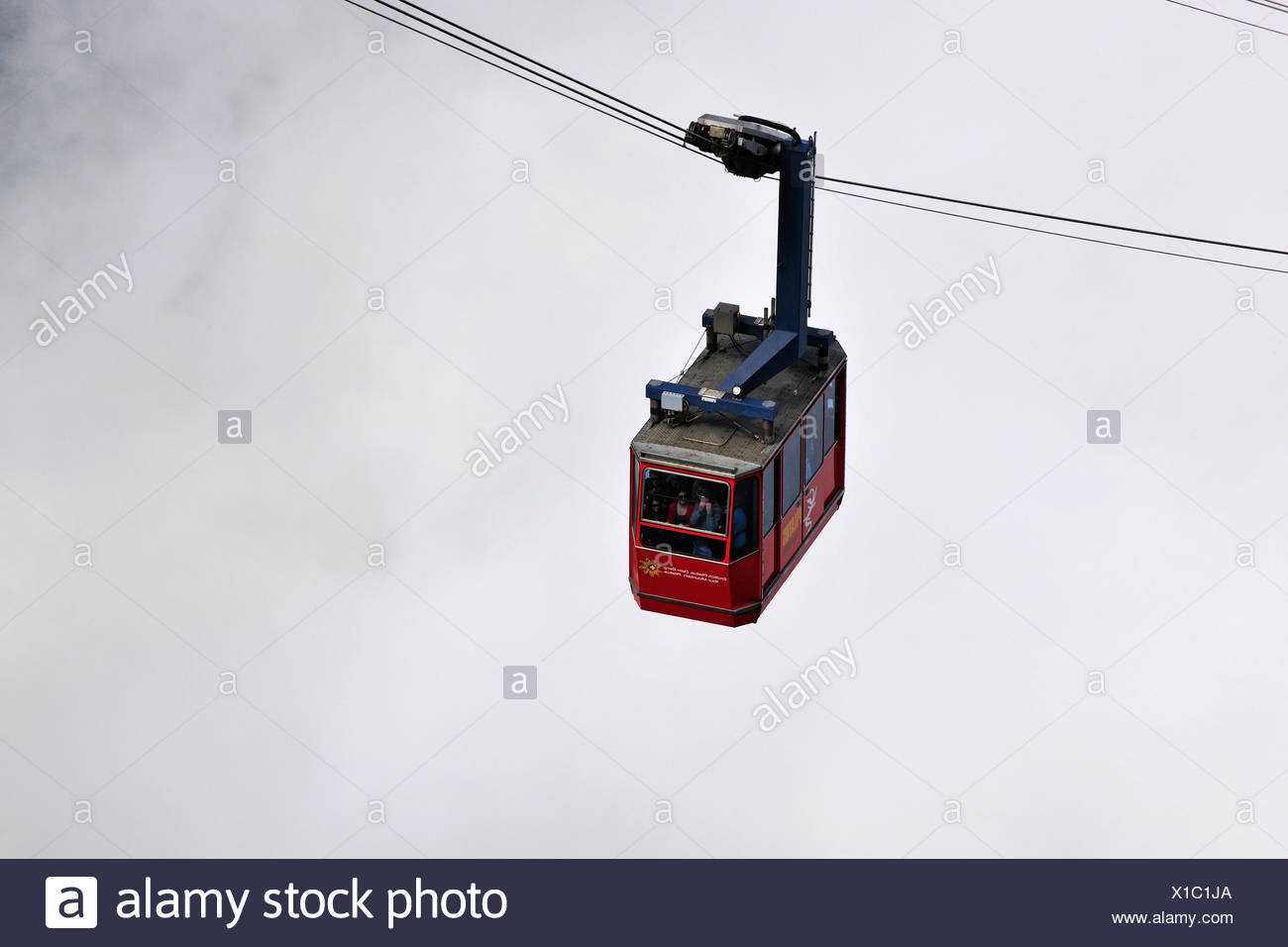 Gondola cableway to Mount Pilatus emerging from a sea of fog, Mount Pilatus, a recreational mountain at Vierwaldstaettersee, La Stock Photo