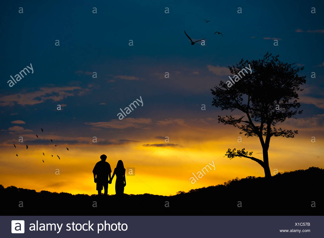 Couple in love at romantic landscape - Stock Image