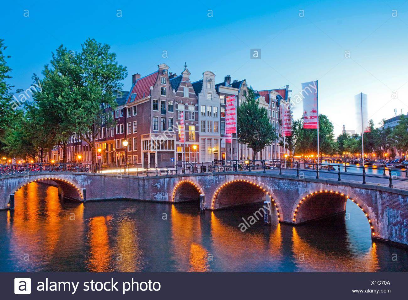 Holland, Netherlands, Europe, Amsterdam, Keizergracht, canal, channel, bridge, in, evening - Stock Image