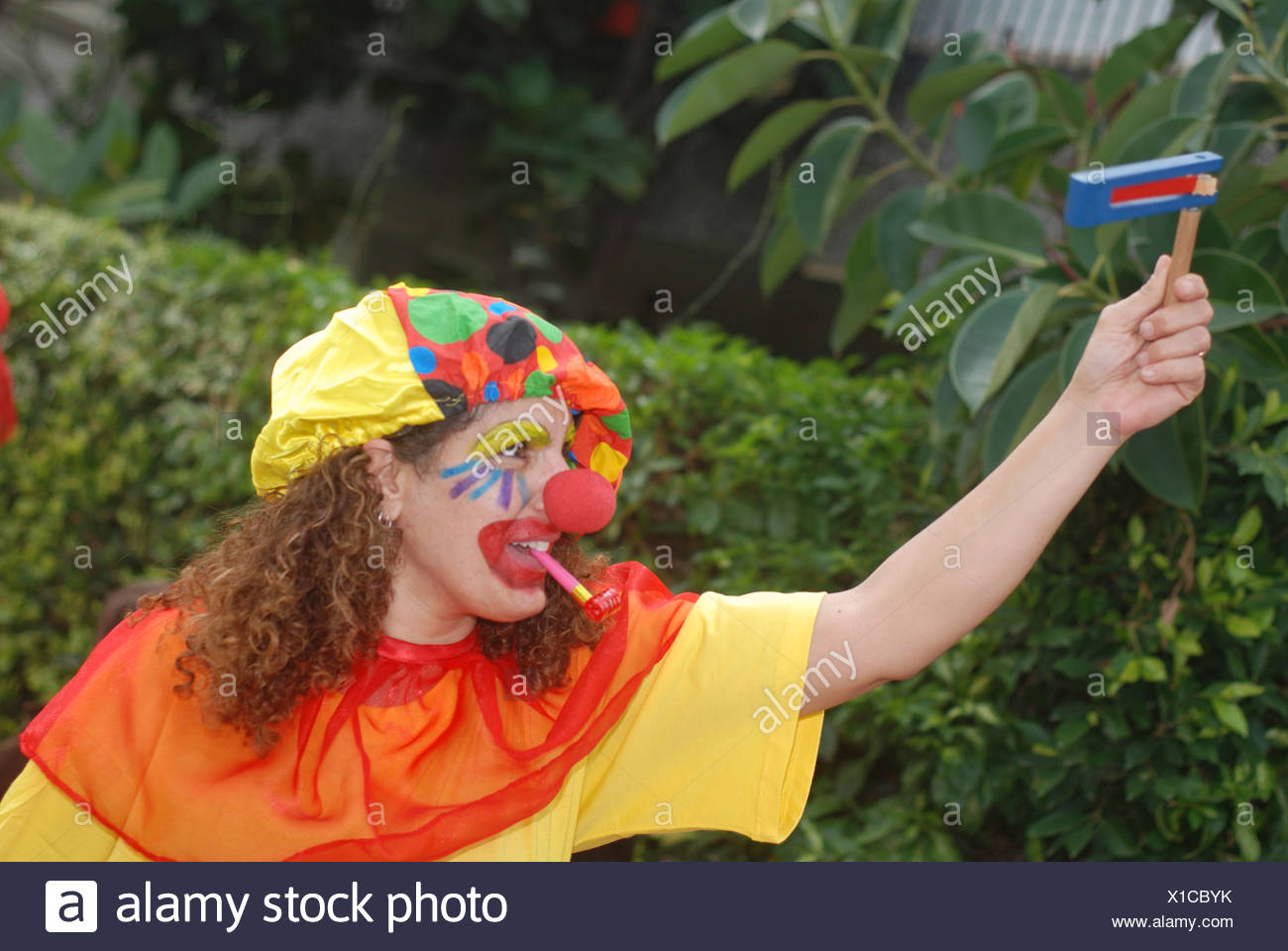 Israel Purim A young woman dressed up as a clown - Stock Image