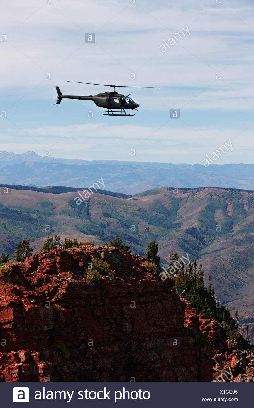 U.S. Army National Guard OH-58 Kiowa in Colorado's Rocky Mountains. - Stock Image