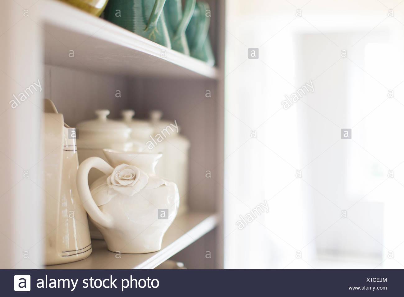 Close up of ceramics on kitchen shelf - Stock Image