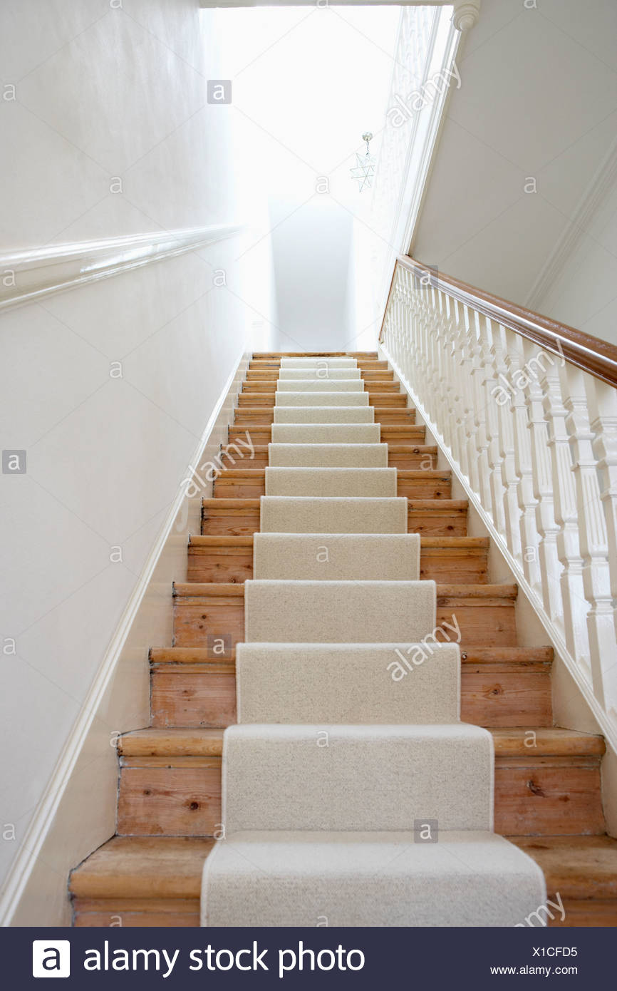 Staircase with runner - Stock Image