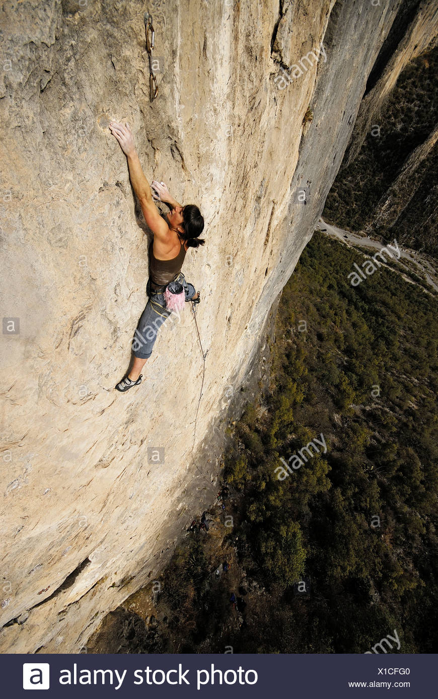 A rock climber ascends a steep rock face in Mexico. - Stock Image