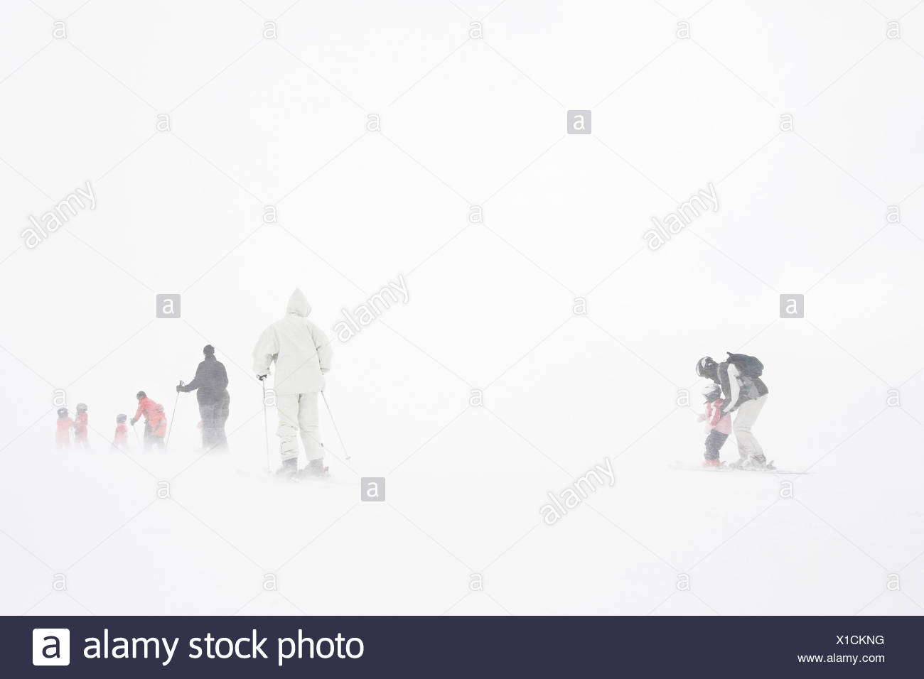 Rear view of a group of people skiingan Alps Switzerland - Stock Image