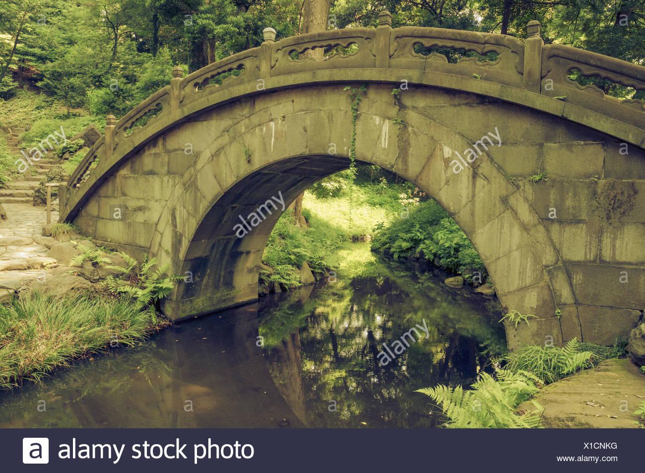 humpbacked bridge - Stock Image