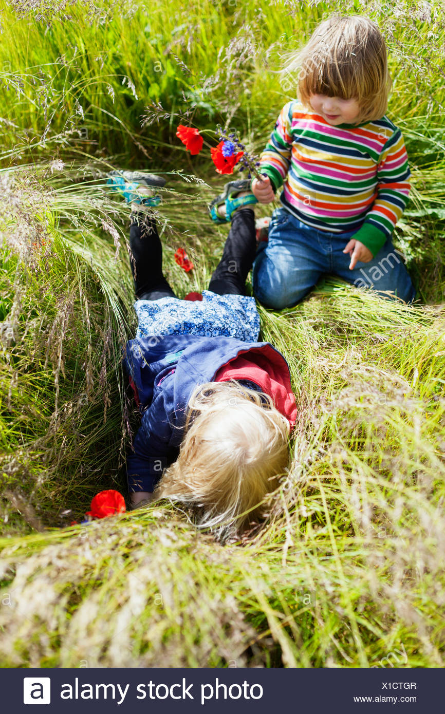 High angle view of girls playing on grassy field - Stock Image