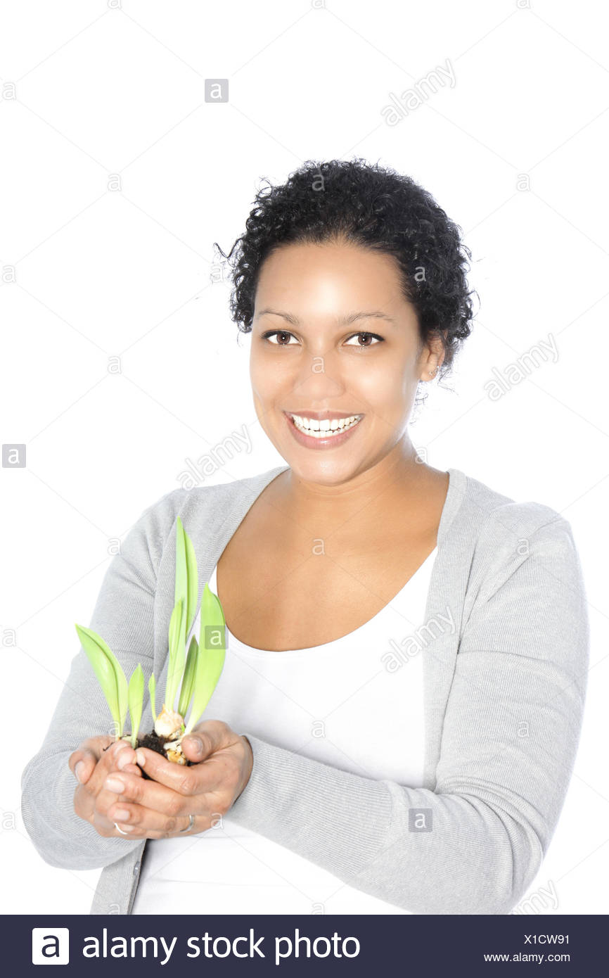 Smiling woman with sprouting sping bulbs - Stock Image