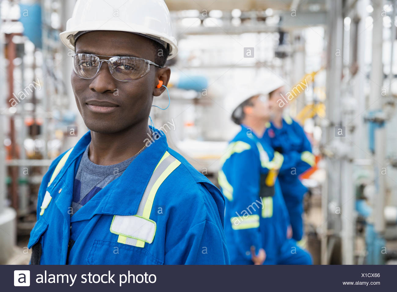 Portrait of confident worker at gas plant - Stock Image