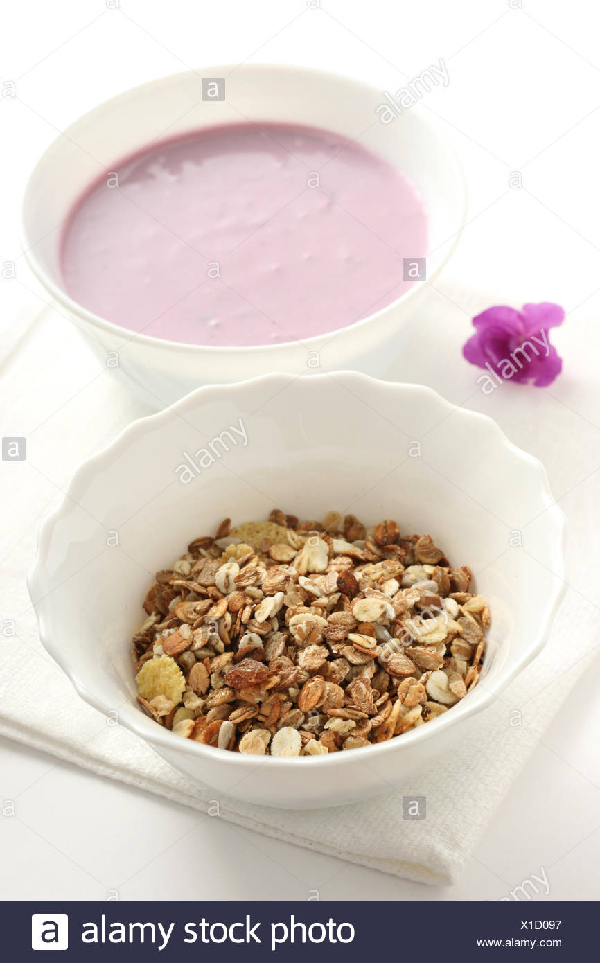 muesli in the bowl with yogurt - Stock Image