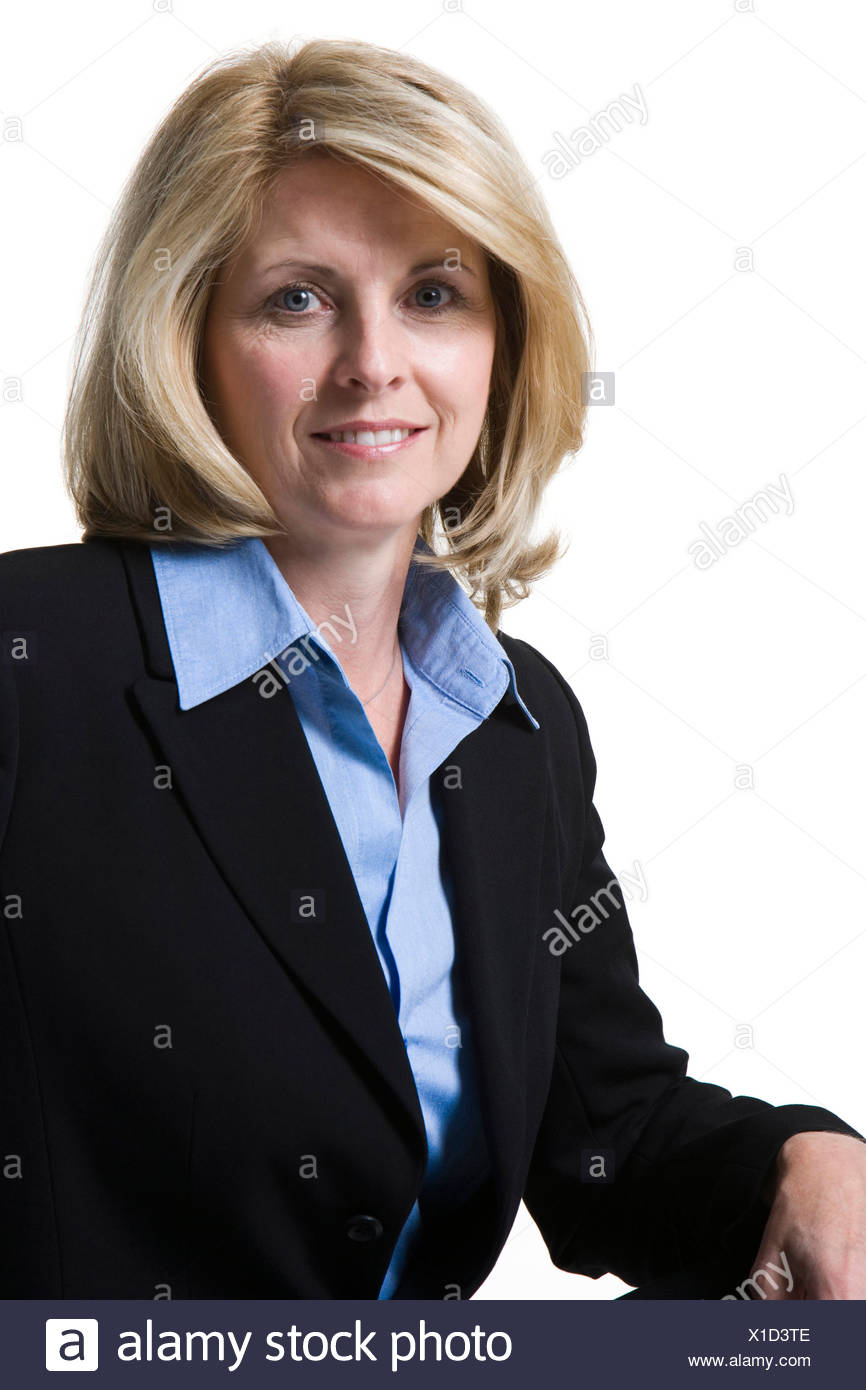 Businesswoman smiling crouching down - Stock Image