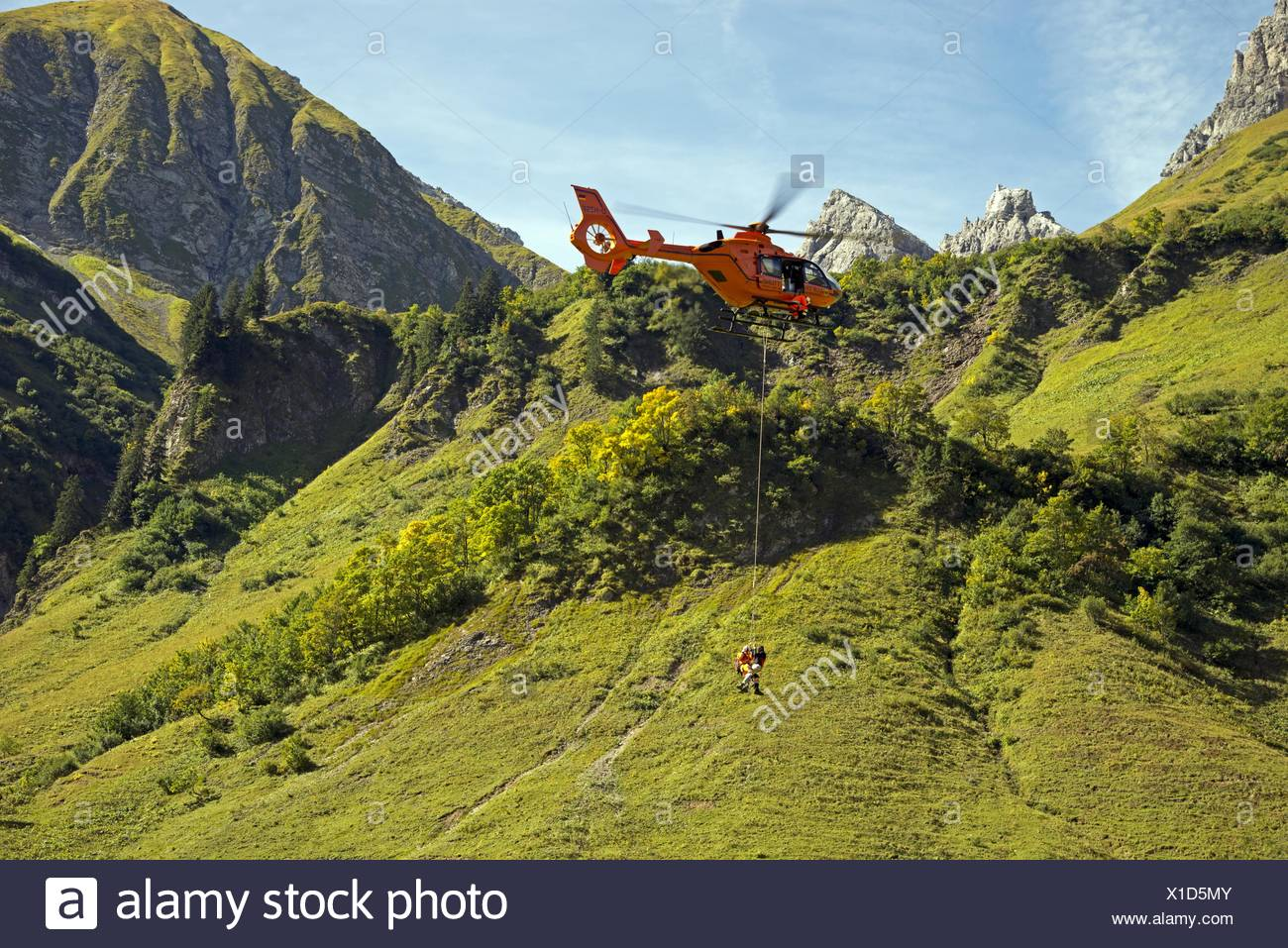 training for a Mountain rescue with a helicopter, Germany, Bavaria, Allgaeu Alps, Oytal Stock Photo